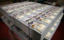 Dollar dünya valyutalarına qarşı ucuzlaşır