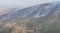 Minalanmış ərazidə yanğın başladı, helikopter göndərildi (VİDEO)